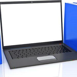 Laptop zwischen Ordnern