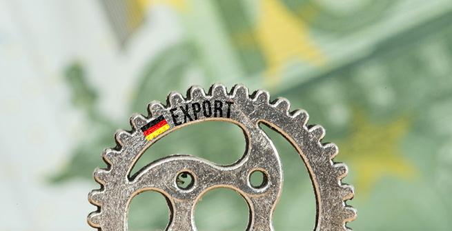 Zahnrad Export vor Geldscheinen