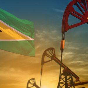 Ölpumpen mit Flagge Guyana
