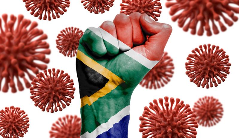 Faust mit Flagge Südafrika vor Coronaviren